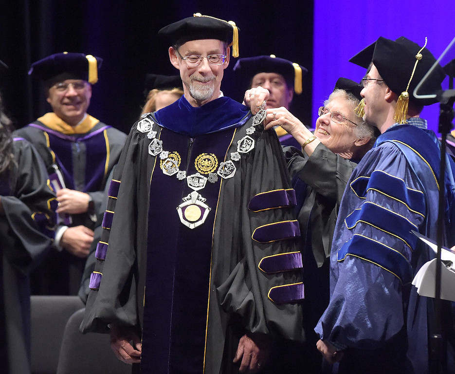 . PETE  BANNAN-DIGITAL FIRST MEDIA         West Chester University President Christopher Fiorentino was formally inaugurated as the president Friday in a ceremony at Emilie K. Asplundh Concert Hall.  Dr. Sandra Mather, Professor Emerita and Thomas Fillippo, chair Council of Trustees  are shown placing the official Presidential Medallion on Fiorentino\'s shoulders..