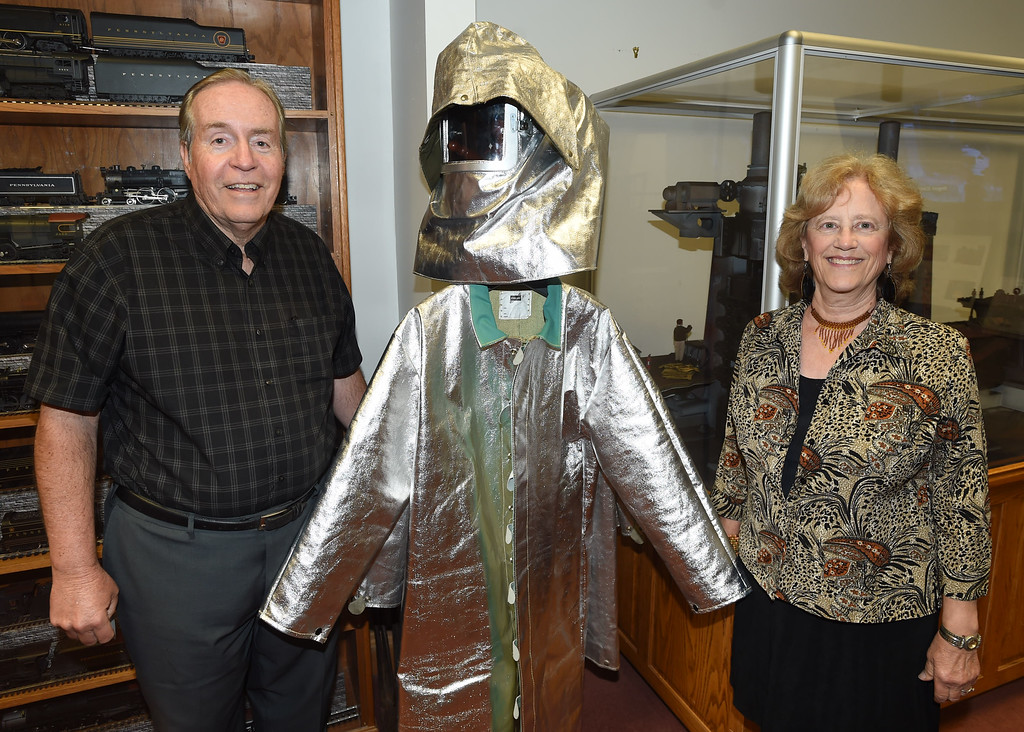 . PETE BANNAN-DIGITAL FIRST MEDIA   Dr. Richard  and Jean Niemeyer of Leola with a blast furnace jacket in the National Iron & Steel Heritage Museum.