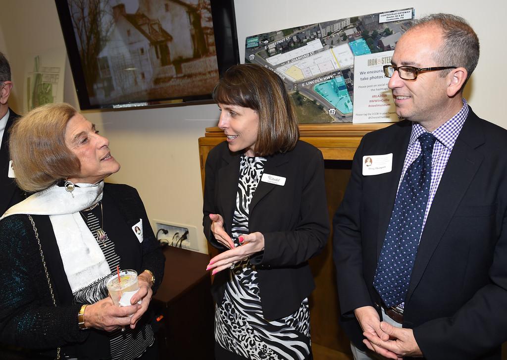 . PETE BANNAN-DIGITAL FIRST MEDIA   Rebecca Lukens Award winner,Barbara Cohen talks with Citadel Bank manager Gwen Smoker and Graystone Committee member Doug Thompson.