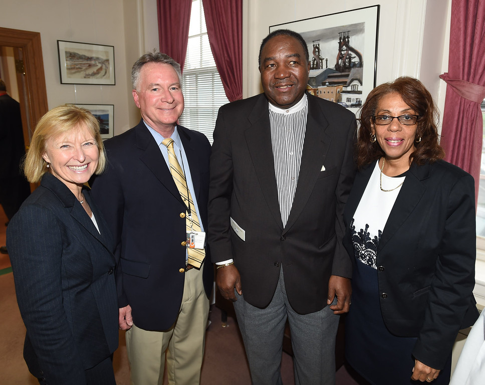 . PETE BANNAN-DIGITAL FIRST MEDIA   Frances Sheehan, CEO of Brandywine Health, James D. Ziegler, executive director of the National Iron and Steel Heritage Museum, Bobby Duncan, pastor of Greater Deliverance church in S. Coatesville and his wife Stephanie.
