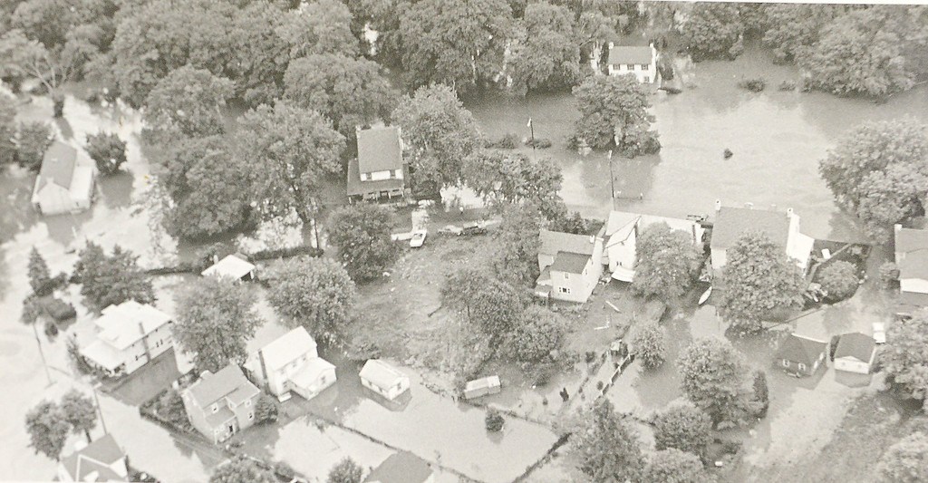 . DAILY LOCAL ARCHIVES   - Following Hurricane Agnes, between Phonixville and Norristown.