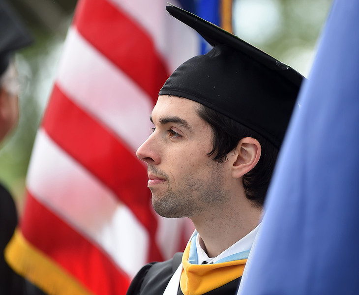 PETE BANNAN-DIGITAL FIRST MEDIA Luke Keeler carried the Pennsylvania state flag into graduation  as Immaculata University held its 92nd Commencement on campus Sunday May 15, 2016.  Degrees were handed out to 888 graduates, including 72 doctorate degrees, 186 master's degrees, 625 bachelor's degrees and five associate degrees.