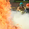 PETE BANNAN-DIGItAL FIRST MEDIA   East Brandywine Junior firefighter, Erin Wang extinguishes a training funder the supervision of Instructor Jim Reagan at the Chester County Emergency Services training center Monday afternoon as part of the junior public safety camp.