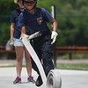 PETE BANNAN-DIGItAL FIRST MEDIA  Keystone Valley junior firefighter Michael Lavendar,14, unrolls a hose at the Chester County Emergency Services training center Monday afternoon as part of the junior public safety camp.