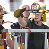PETE BANNAN  DIGITAL FIRST MEDIA  Lucas Richardson of Twin Valley Fire  Company,right, helps Sam Curdo of W. Bradford Fire Cmpany as they tie the clove hitch knot Chester County Department of Emergency Services' Junior Public Safety Camp Olympics Thursday at the Chester County Public Safety Training Campus, Tactical Village in S. Coatesville. The Junior Olympics takes the skills that the students, aged 14 to 17, have spent a week learning and puts them to practical use in various scenarios.