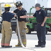 PETE BANNAN  DIGITAL FIRST MEDIA   Fire instructor David McKinney oversees, Joshua Skettett of Thorndale Fire Company and Corban Schwartz of Fame Fire company during Chester County Department of Emergency Services' Junior Public Safety Camp Olympics Thursday at the Chester County Public Safety Training Campus, Tactical Village in S. Coatesville  The Junior Olympics takes the skills that the students, aged 14 to 17, have spent a week learning and puts them to practical use in various scenarios.