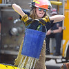 PETE BANNAN  DIGITAL FIRST MEDIA   Hannah Matlack of the Glen Moore Fire company takes part in the buck brigade component of Chester County Department of Emergency Services' Junior Public Safety Camp Olympics Thursday at the Chester County Public Safety Training Campus, Tactical Village in S. Coatesville. The bucket has holes drilled in it to make the test more challenging.  The Junior Olympics takes the skills that the students, aged 14 to 17, have spent a week learning and puts them to practical use in various scenarios.