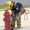 PETE BANNAN  DIGITAL FIRST MEDIA   Elijah ROmano of Valley Forge Fire Company attaches a hose to the hydrent during Chester County Department of Emergency Services' Junior Public Safety Camp Olympics Thursday at the Chester County Public Safety Training Campus, Tactical Village in S. Coatesville  The Junior Olympics takes the skills that the students, aged 14 to 17, have spent a week learning and puts them to practical use in various scenarios.