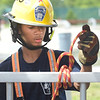 PETE BANNAN  DIGITAL FIRST MEDIA  Joshua Skerrett of the Thorndale Fire company ties a clove hitch knot Chester County Department of Emergency Services' Junior Public Safety Camp Olympics Thursday at the Chester County Public Safety Training Campus, Tactical Village in S. Coatesville. The Junior Olympics takes the skills that the students, aged 14 to 17, have spent a week learning and puts them to practical use in various scenarios.