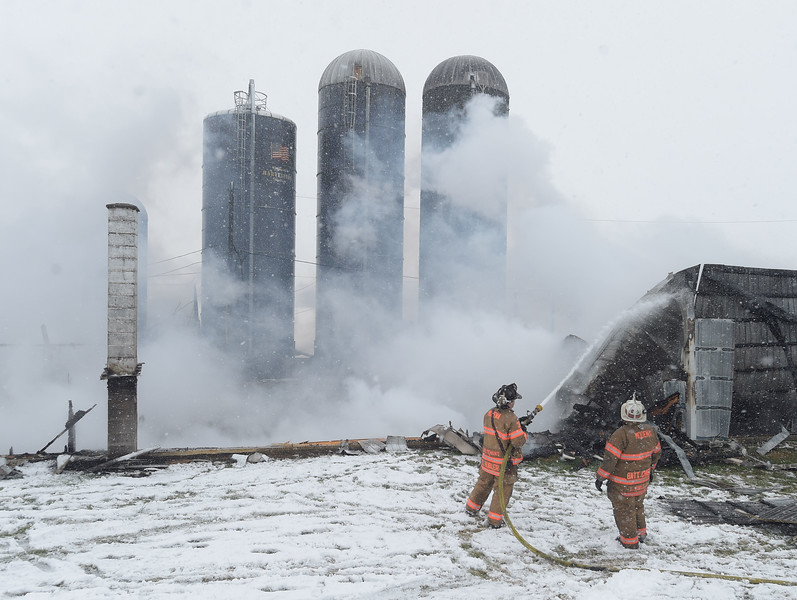 HIGHLAND >> A raging fire roared through a farm building in the township Friday morning, authorities said.<br /> No injuries were reported, but the  workshop building was destroyed and several pieces of farm equipment went up in flames.<br /> No animals were injured in the blaze.  PETE BANNAN-DIGITAL FIRST MEDIA