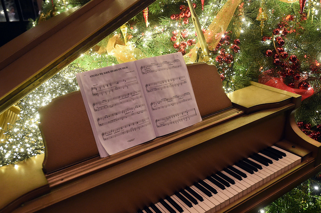 ". PETE  BANNAN-DIGITAL FIRST MEDIA     ""Angels We Have Heard on High\"" on the piano in the Conservatory at Longwood Gardens."