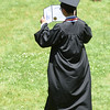 PETE BANNAN-DIGITAL FIRST MEDIA  A Malvern Preparatory School graduate takes a moment to look at his diploma following graduation Thursday Jun 2, 2016, 115 graduates received their diplomas.