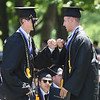 PETE BANNAN-DIGITAL FIRST MEDIA  A Malvern Preparatory School graduates  Michael John Hollingsworth and James John Harrington exchange a fist bump during graduation ceremonies at the school Thursday June 2, 2016.Harrington will attend Buckenell while Hollingsworth will attend Lehigh University in the fall.
