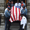PETE BANNAN-DIGITAL FIRST MEDIA   West Chester police and Marine Corp League members carry the coffin of former West Chester mayor Dick Yoder from St. Agnes Church. Yoder was  the two term Mayor of the Borough of West Chester (2002-10) and a six year veteran of the United States Marine Corps.