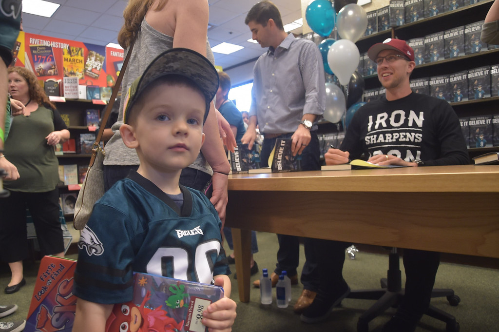 . PETE  BANNAN-DIGITAL FIRST MEDIA      Jeffrey Mascitelli,3, of Springfield was one of many to greet Eagles quarterback Nick Foles who was at the Barnes & Nobles in Tredyffrin Thursday evening to sign copies of his book, Believe It: My Journey of Success, Failure, and Overcoming the Odds.