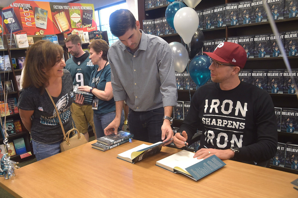 . PETE  BANNAN-DIGITAL FIRST MEDIA         (Left) Lisa Callaghan, of West Chester says a quick hello to  Eagles quarterback Nick Foles who was at the Barnes & Nobles in Tredyffrin Thursday evening to sign copies of his book, Believe It: My Journey of Success, Failure, and Overcoming the Odds.