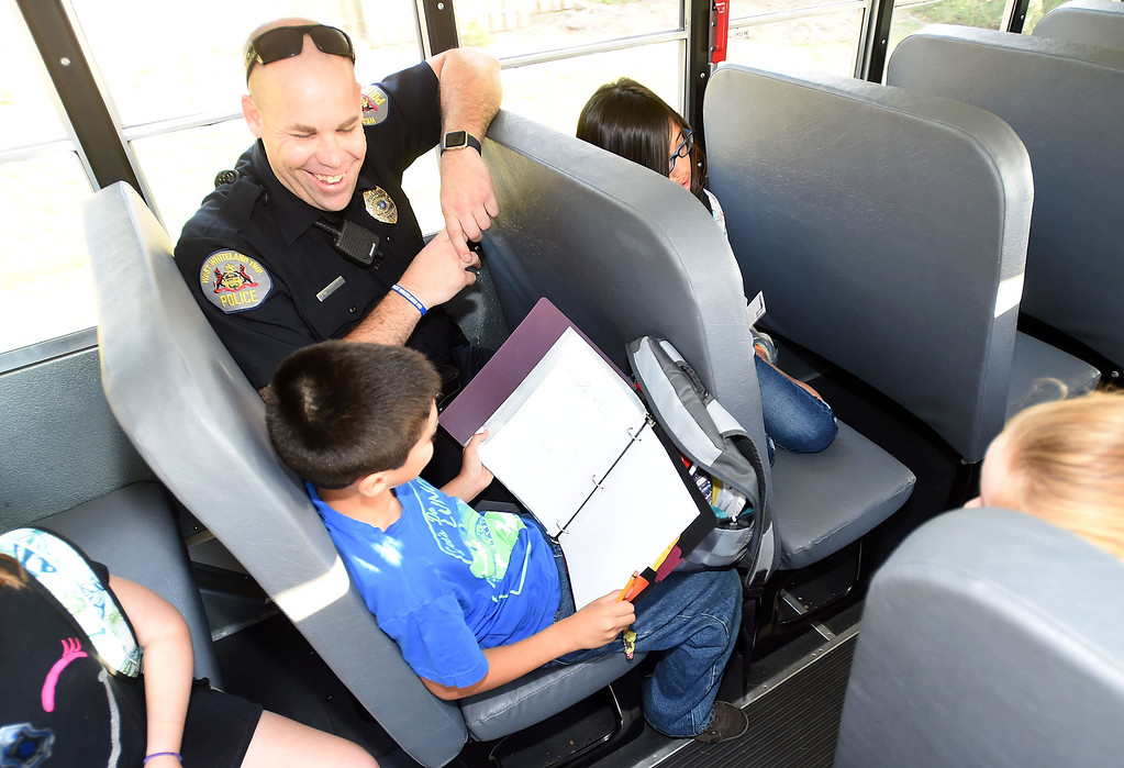 . PETE  BANNAN-DIGITAL FIRST MEDIA         West Whiteland Police Detective Jeff McCloskey rode the school bus to Mary C. Howse Elementary Wednesday to speak to the children about school bus safety as part of Operation Safe Stop.  Operation Safe Stop is part of National School Bus Safety Week,  a public awareness and enforcement effort to educate the motoring public that passing a stopped school bus, is dangerous and illegal.