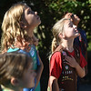 PETE  BANNAN-DIGITAL FIRST MEDIA  Bradford Heights Elementary School Girl Scouts Josie Provencher,9, Abby Moyers,10, and Vivian Quinn,8, hold their hearts during the Pledge of Alliance.
