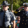 PETE  BANNAN-DIGITAL FIRST MEDIA   Pennsylvania State Troop Barnett and West Bradford Fire Chief Jack Law  salutes the flag during Bradford Heights Elementary's Patriots Day Flag Raising ceremony Monday, Sept. 12, 2016.  A student honor guard of Girl and Boy scouts raised the flag,recited the Pledge of Alliance and held a moment of silence.