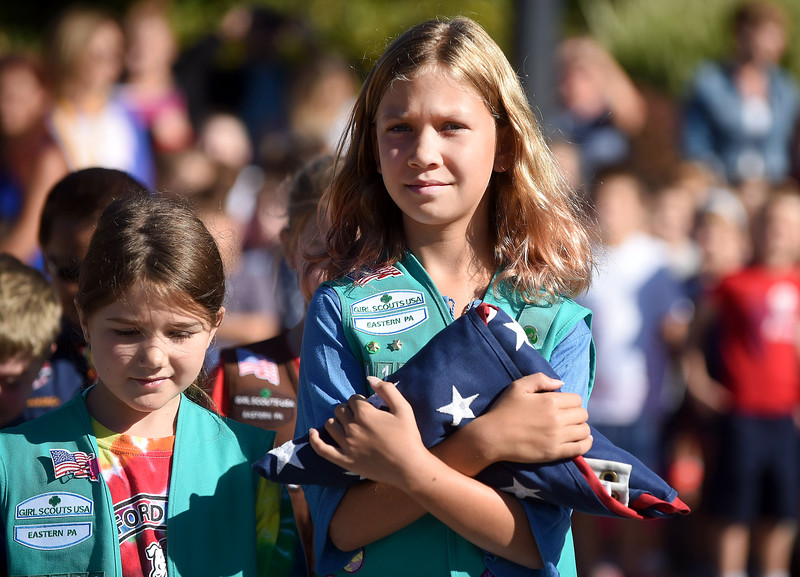 PETE  BANNAN-DIGITAL FIRST MEDIA  Girl Scout Abby Moyers,10, troop 4172 carries the flag in Bradford Heights Elementary's Patriots Day Flag Raising ceremony Monday, Sept. 12, 2016.  The student honor guard of Girl and Boy scouts raised the flag,recited the Pledge of Alliance and held a moment of silence as the student body and area dignitaries and parents joined in attendance..
