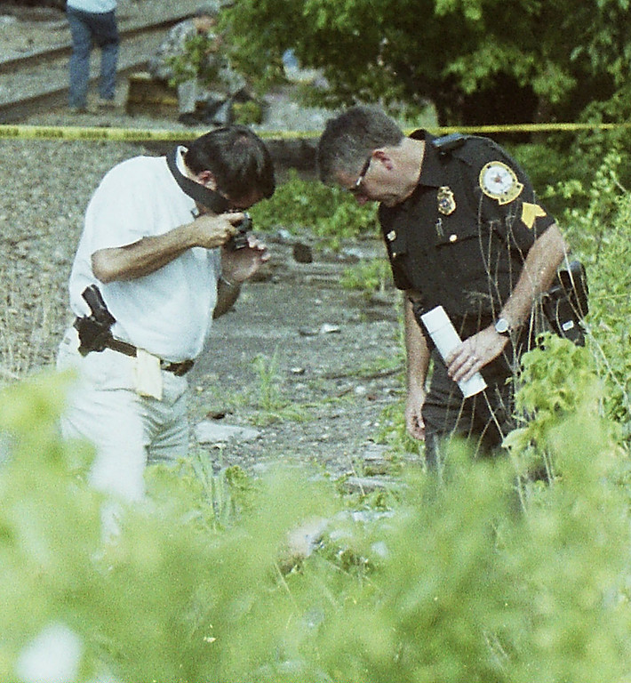 . Malvern police investigate a July 15 2001 suicide on the train tracks.