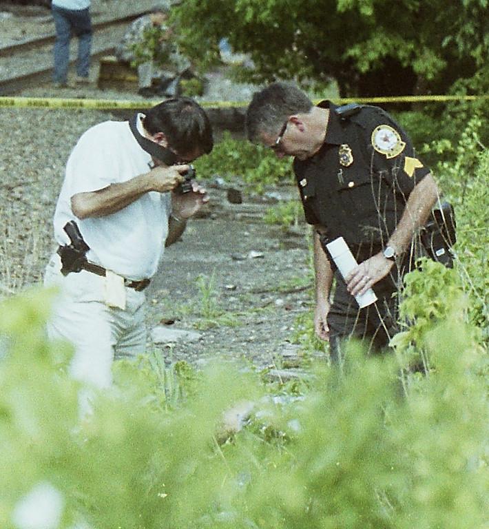 . Malvern police investigate a July 15 2001 suicide on the train tracks.