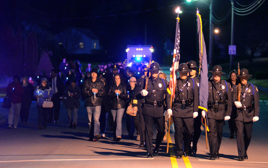 . VINNY TENNIS - Daily Local News  The West Goshen Police Honor Guard leads the procession to the Victim\'s Memorial during the Crime Victims\' Center of Chester County candlelight vigil and memorial service in Downingtown on Thursday, April 23, 2015.