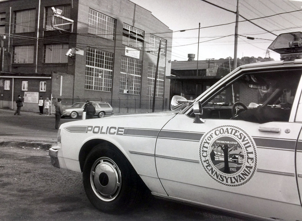 ". ""Off-Duty\"" Coatesville policeman at Lukens Gate off of Strode Ave and business Route 30.  Proof photo states No face or I.D. peritted!  October 29, 1991.  Staff photo by John Stonebeck"