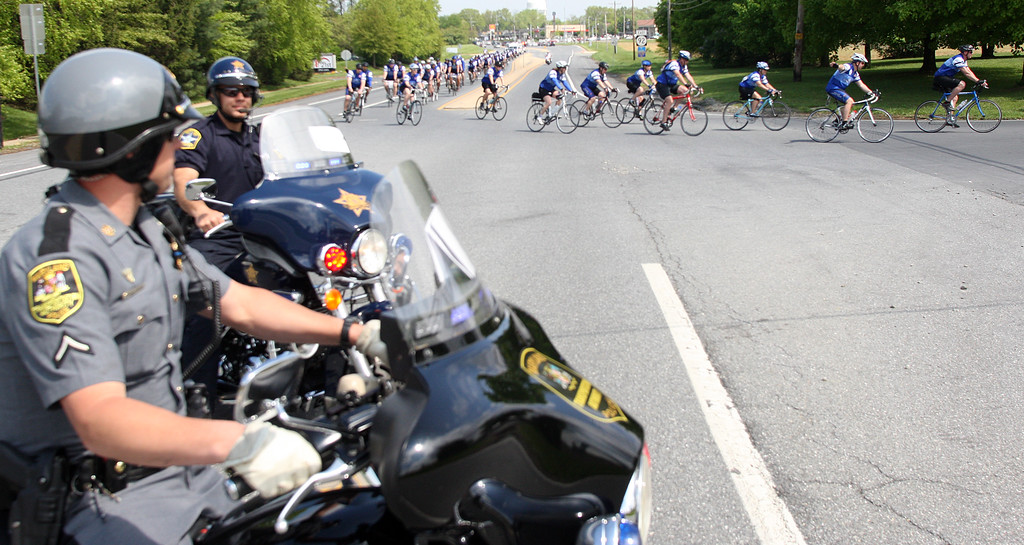 . Staff Photo By Vinny Tennis  Motorcycle officers stop traffic during the Police Unity Tour in Delaware on Thursday, May 9, 2013. Law Enforcement Officers are riding about 280 miles from Philadelphia to Washington D.C. ending at the National Law Enforcement Memorial Wall and Museum.