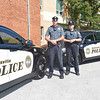 VINNY TENNIS - Daily Local News<br /> <br /> Officers Chris McCarthy and Claire Lang stand next to two new police cars delivered to the Coatesville Police Department recently.