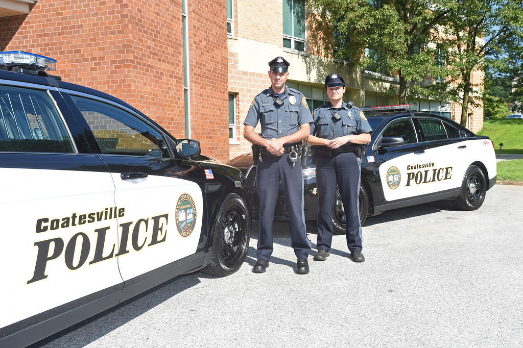 . VINNY TENNIS - Daily Local News  Officers Chris McCarthy and Claire Lang stand next to two new police cars delivered to the Coatesville Police Department recently.