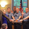 VINNY TENNIS - Daily Local News<br /> <br /> New Downingtown Borough Police Officers are sworn in during a borough council meeting in Downingtown on Wednesday, May 6, 2015. From left, Jim Chance, Stefanie Dunne, Caleb Komorowski, Geoffrey Burkhart, Brandon, Seibert, and Kurt Gavina.