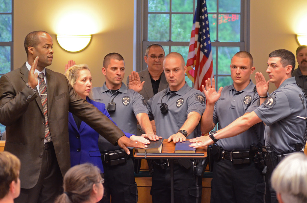 . VINNY TENNIS - Daily Local News  New Downingtown Borough Police Officers are sworn in during a borough council meeting in Downingtown on Wednesday, May 6, 2015. From left, Jim Chance, Stefanie Dunne, Caleb Komorowski, Geoffrey Burkhart, Brandon, Seibert, and Kurt Gavina.