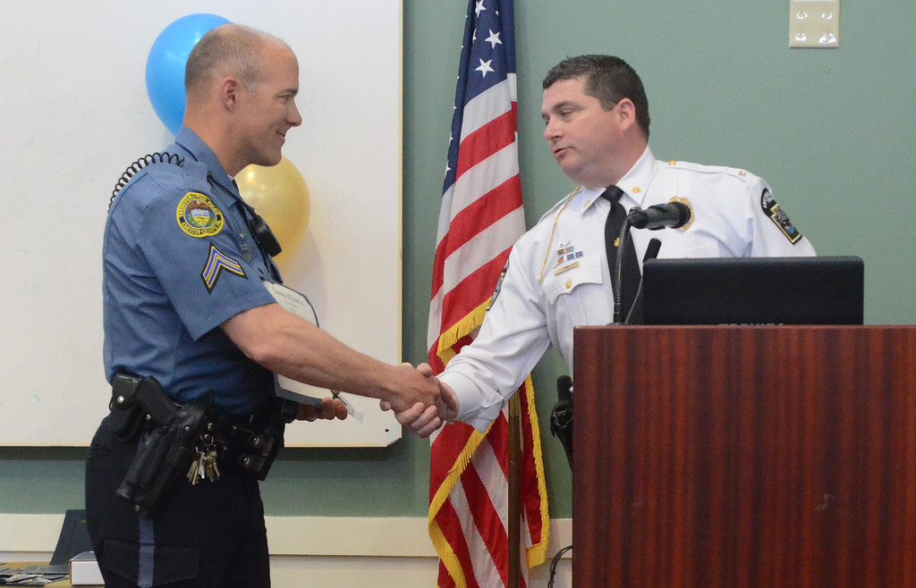 . VINNY TENNIS - Daily Local News  Cpl. Kreg Isleib, left, is awarded a Commendation of Merit from East Vincent Police Chief Matt Williams at the Treyffrin Twp. Police Department 2015 awards ceremony in Tredyffrin on Wednesday, April 29, 2015. Isleib was off duty at home when he responded and help apprehend a burglary suspect.