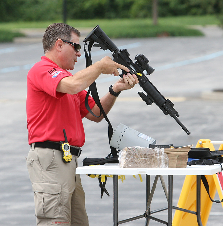 """. Staff Photo By Vinny Tennis   Michael Alexander clears all firearms of live ammunition and mark them \""""Safe\"""" as police officers arrive for a multi-jurisdictional public safety exercise involving an active shooter at Conestoga High School in Berwyn on Tuesday, Aug. 6, 2013. Tredyffrin Twp. Police Department and the Easttown Twp. Police Department brought together all disciplines of public safety, police, fire and EMS, as well as County agencies to participate in the drill."""
