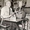 DAILY LOCAL ARCHIVES - West Chester Sgt. Linwood Bonner at his desk with  a pup found on S. Walnut st. Dec. 2,1962.
