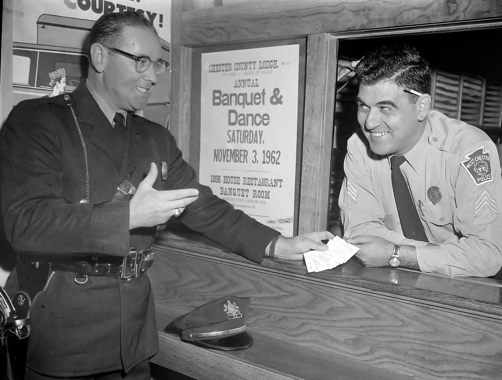 . TICKET DISCUSSION. HArry Saltzman and Joseph Cialini, West Chester police officers, discuss a ticket situation, but not of the parking variety.  Saltzman is chairman of the county FOP lodge\'s annual banquet and dance to be held at the Downingtown Motor Inn. Cialini is a member of the entertainment committee. For further details check the poster.  D.L>N. Staff Photo   Oct. 30, 1962
