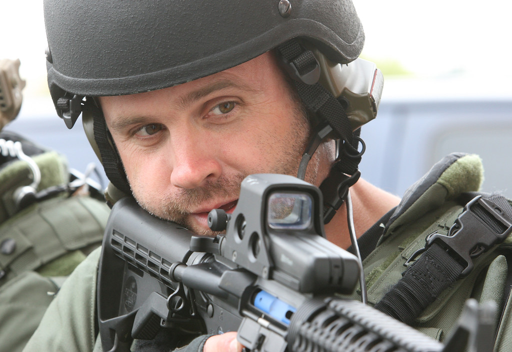 . Staff Photo by Vinny Tennis  Jeff Heim, a detective with Willistown Police, prepares to enter a building during a training exercise on Thursday April 26, 2012. The West Chester Regional Emergency Response Team was learning advanced SWAT team tactics taught by Navy SEALs and other members of the military\'s special forces. The training was being held in the former West Whiteland Township building with a flashing sign .