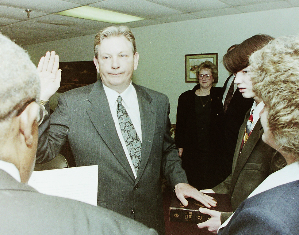 . New Oxford police Chief Walter J. Donahue is sworn in Saturday Feb. 19, 1995 by Mayor Harold Gray. Donahue\'s wife, Patricia, and son, TIm, hold the Bible.