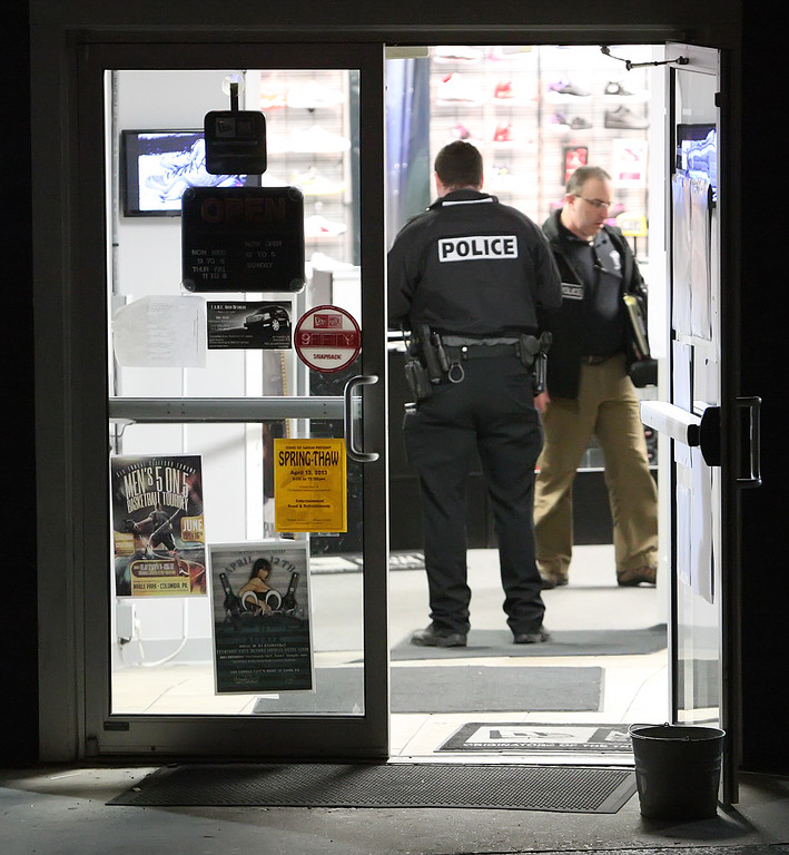 . Lancaster City Police investigate a shooting at The Image store at the corner of Union and Laurel streets in Lancaster on Saturday, April 6, 2013.