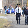 VINNY TENNIS - Daily Local News<br /> <br />  West Goshen Township Police Chief Joseph Gleason, left, and Tim Monville, Senior Air Safety Investigator with the National Transportation Safety Board walk from the site of a fatal plane crash in 1000 block of Saunders Lane in West Goshen on Monday, March 30, 2015. The plane crash which occurred Sunday afternoon claimed the lives of two people.