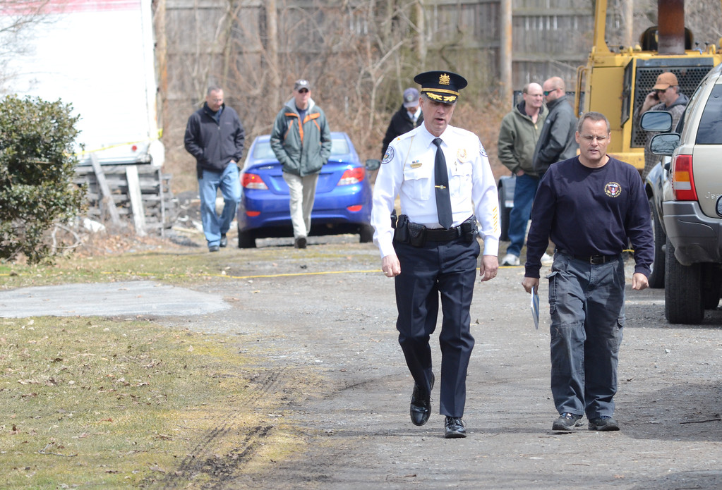 . VINNY TENNIS - Daily Local News   West Goshen Township Police Chief Joseph Gleason, left, and Tim Monville, Senior Air Safety Investigator with the National Transportation Safety Board walk from the site of a fatal plane crash in 1000 block of Saunders Lane in West Goshen on Monday, March 30, 2015. The plane crash which occurred Sunday afternoon claimed the lives of two people.