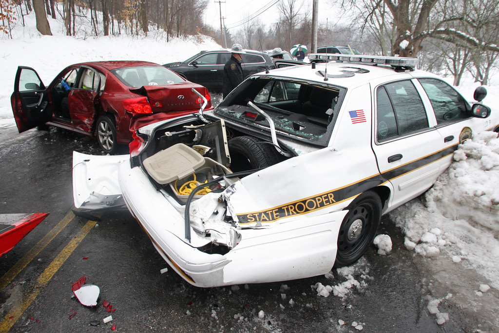 . Staff Photo by Vinny Tennis  Approximately 14 cars including a Pennsylvania State Police cruiser, were involved in a crash on icy road conditions in the 1800 block of Shadyside Road in West Bradford on Wednesday, Feb. 19, 2014. The accident which happened shortly before 8:45 sent two people to the hospital for evaluation. Drivers said they were unable to stop on the ice, and steered into the snowbanks to avoid running into other cars.