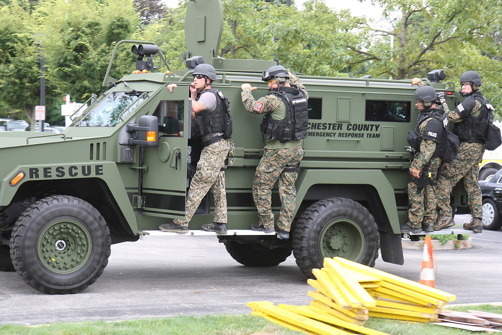 . Staff Photo By Vinny Tennis   SWAT officers advance to a building during a multi-jurisdictional public safety exercise involving an active shooter at Conestoga High School in Berwyn on Tuesday, Aug. 6, 2013. Tredyffrin Twp. Police Department and the Easttown Twp. Police Department brought together all disciplines of public safety, police, fire and EMS, as well as County agencies to participate in the drill.