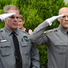 VINNY TENNIS - Daily Local News<br /> <br /> South Coatesville Police officers salute as Officer Arthur Moody is carried to the hearse at Second Baptist Church in Coatesville on Friday, July 17, 2015. Officer Moody passed away suddenly on July 7.