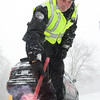 Staff Photo by Vinny Tennis<br /> <br /> <br /> West Brandywine Police Officer James Bilski lights another flare at the intersection of Route 82 and Hibernia Road in West Brandywine on Tuesday, Jan. 21, 2014. Route 82 was closed from 340 to 322 for to remove the trucks and for PennDOT plow and salt the roadway.