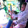 PETE  BANNAN-DIGITAL FIRST MEDIA    <br /> Ryniah  Bellamy,3, of Coatesville tries out a Japanes style arcade game at Round 1 at Exton Mall .