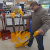 "PETE  BANNAN-DIGITAL FIRST MEDIA     Tim Saunders of West Chester compares snow shovels at Ace Hardware of West Chester Monday afternoon March 13, 2017 in preperation for the snowstorm expected to move across Chester County Tuesday. ""We  have our house done but I need something for the car,"" he said."