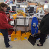 "PETE  BANNAN-DIGITAL FIRST MEDIA     Pat Solon of  West Chester asks  Ace Hardware of West Chester fowner Helene Claire about a new shovel sleds Monday afternoon March 13, 2017 ahead of the snowstorm expected to move across Chester County Tuesday. ""We 4 grandbabies coming and we want to be ready,"" she said. ""I was really looking for one with a boy attached,"" she joked."
