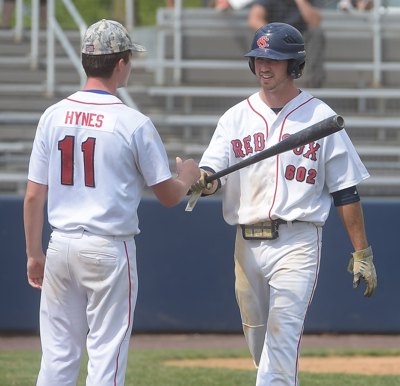 . PETE BANNAN  DIGITAL FIRST MEDIA   Spring City (8) Sean McHugh gets congratulations from teammate (11) Kevin Hynes after scoring to help the Red Sox defeated Lionville 9-5 Tuesday at Immaculata University to wrap up its first Chester County American Legion Baseball championship since 2012.